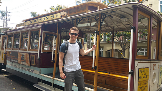 Brad hanging off a cable car (image: Alexandra Gregg)