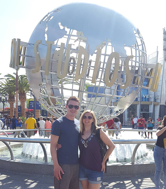 Me and fiancé in front of the Universal Studios Hollywood ball (image: Alexandra Gregg)