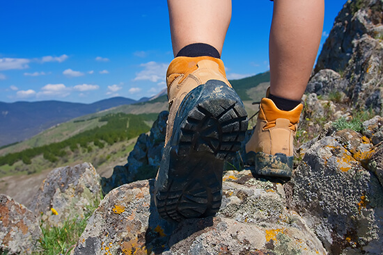 Worn-in hiking boots are perhaps the most important thing to pack