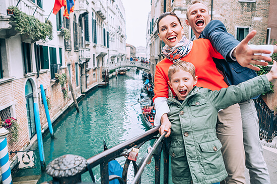 Family on the canals in Venice