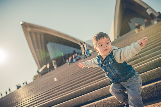 Young boy outside the Sydney Opera House