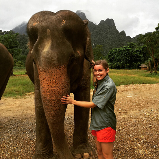 Tess with an elephant at Elephant Hills before embarking on the jungle trek (image: Tessa Watkins)
