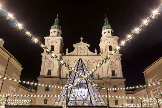 Salzburg Cathedral towering over the Christmas market