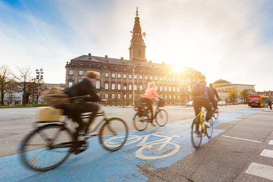 Cycling past Christiansborg Palace, Copenhagen
