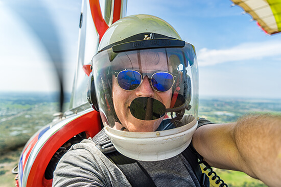RS Ross in a microlight