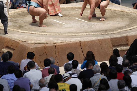 Crowd watching a sumo tournament in Tokyo