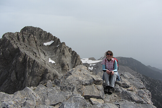Angela with a view of Mytikas Peak behind (image: Angela Griffin)