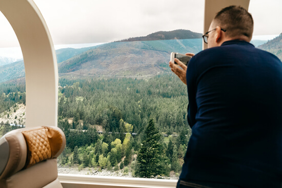 Grabbing a picture through the domed roofed (image: Rocky Mountaineer)