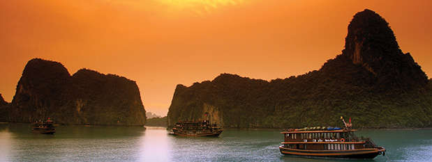 A boat on Halong Bay at Sunset in Vietnam