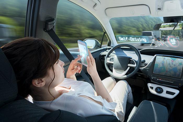 Woman in driverless car