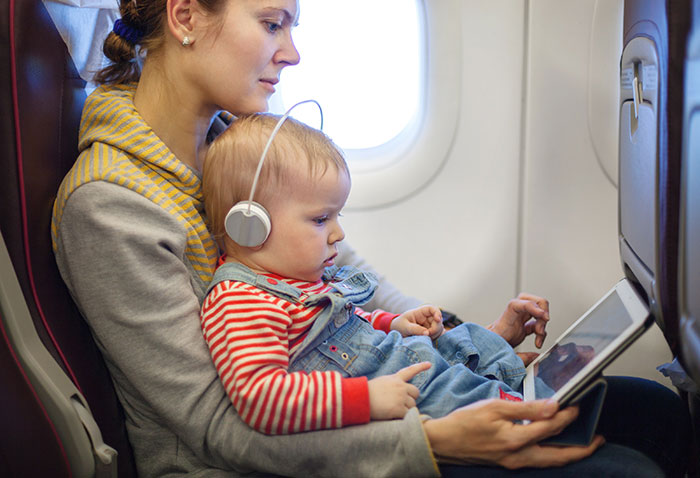 Woman on plane with a toddler