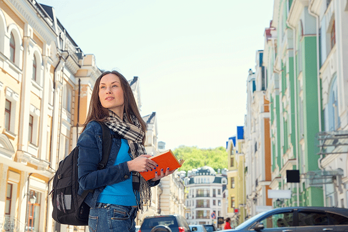 Woman traveller with book