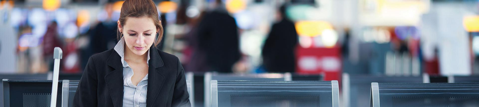 Woman sitting at an airport