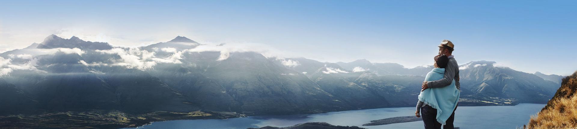 Couple overlooking Lake Wanaka in New Zealand