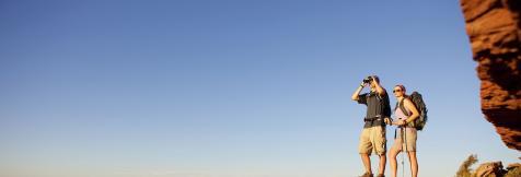 couple standing on rock overlooking Grand Canyon